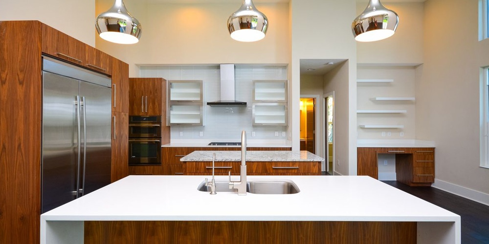 Modern Kitchen walnut cabinets waterfall countertop